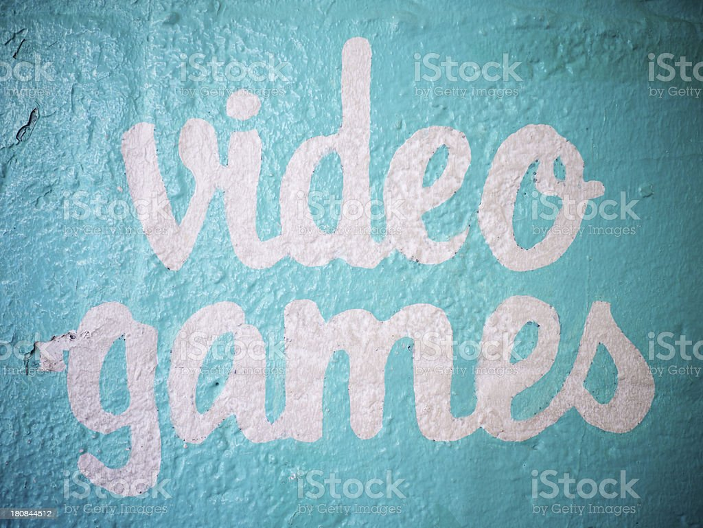 Video Games Sign on Textured Blue Wall royalty-free stock photo