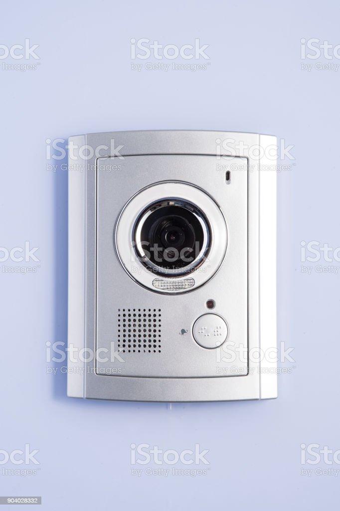 Video intercom device on building exterior wall stock photo