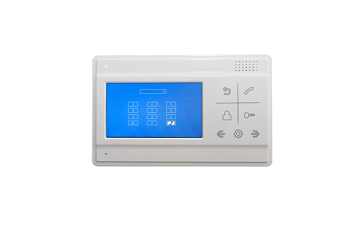video intercom on a white wall near the entrance door to the apartment, isolated.