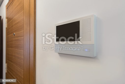 istock Video intercom, security system safety in modern apartment 925680922