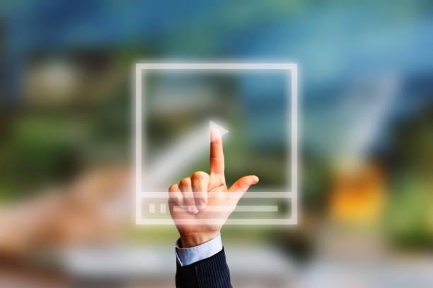 Video Marketing Concept.Hand pressing transparent white button stock photo