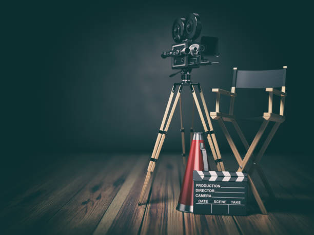 Video, movie, cinema concept. Retro camera, clapperboard and director chair. 3d stock photo