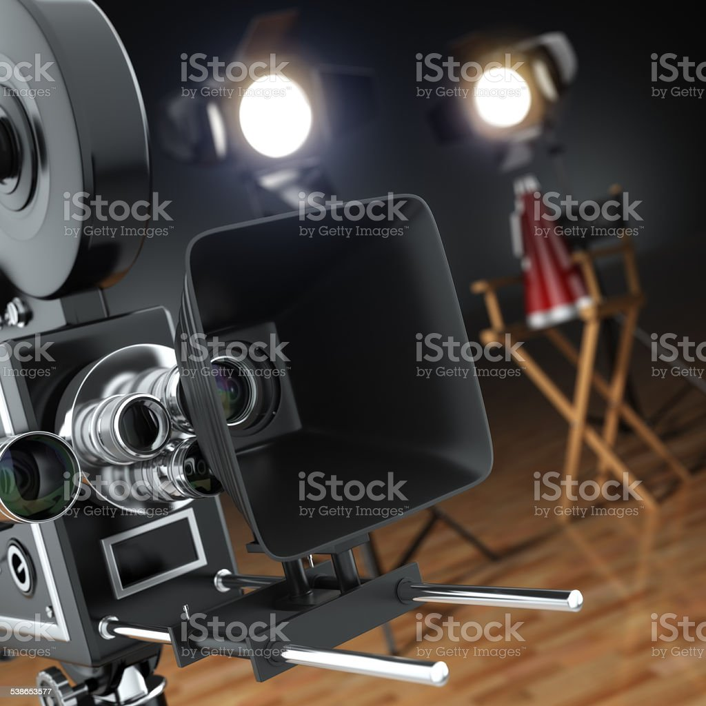 Video, movie, cinema concept. Retro camera, flash and director's stock photo