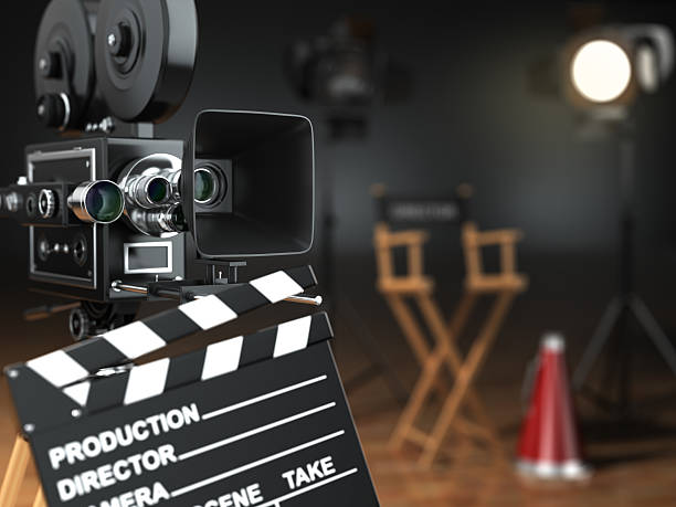 Video, movie, cinema concept. Retro camera, flash, clapperboard stock photo
