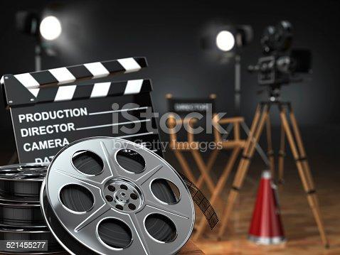 istock Video, movie, cinema concept. Retro camera, reels, clapperboard 521455277
