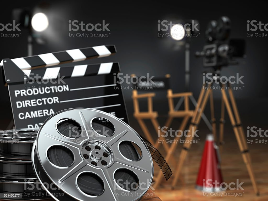 Video, movie, cinema concept. Retro camera, reels, clapperboard stock photo