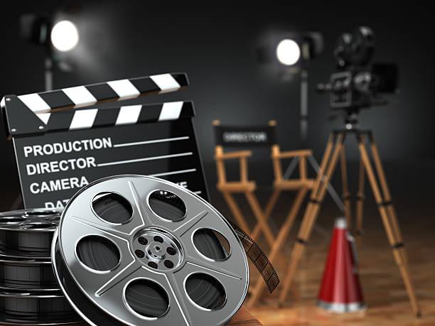 Vidéos, films, cinéma concept.  Appareil photo rétro, moulinets, clapperboard - Photo
