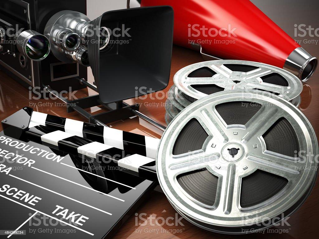 Video, movie, cinema vintage concept. Retro camera, reels and cl stock photo