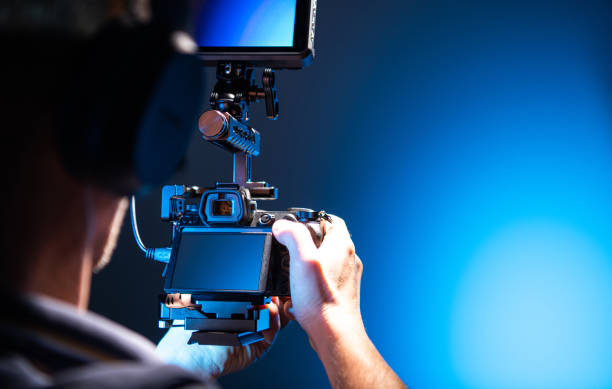 Video Operator with Modern DLSR Camera in Hands stock photo