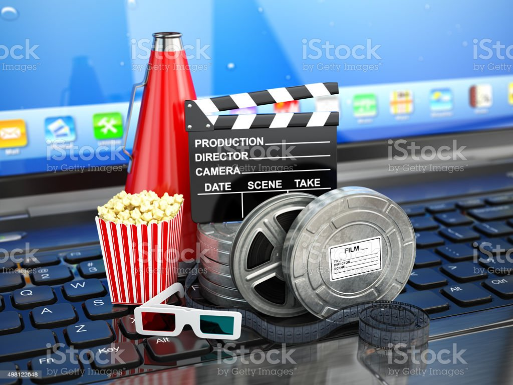 Video or movie online internet concept. Film reels, clapperboard stock photo