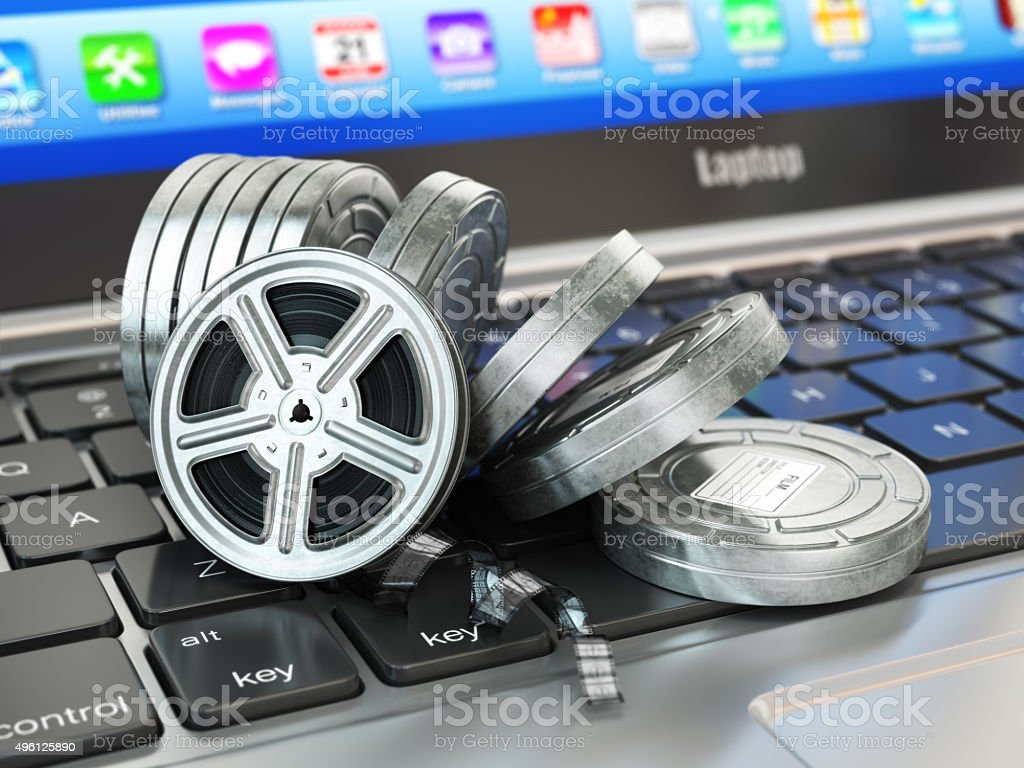 Video or movie online internet concept. Film reels on laptop stock photo