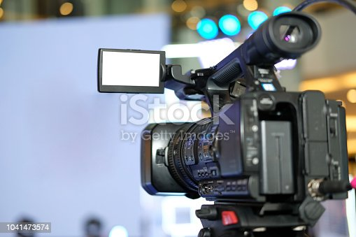 professional video production camera recording live event on stage. television social media broadcasting seminar conference.