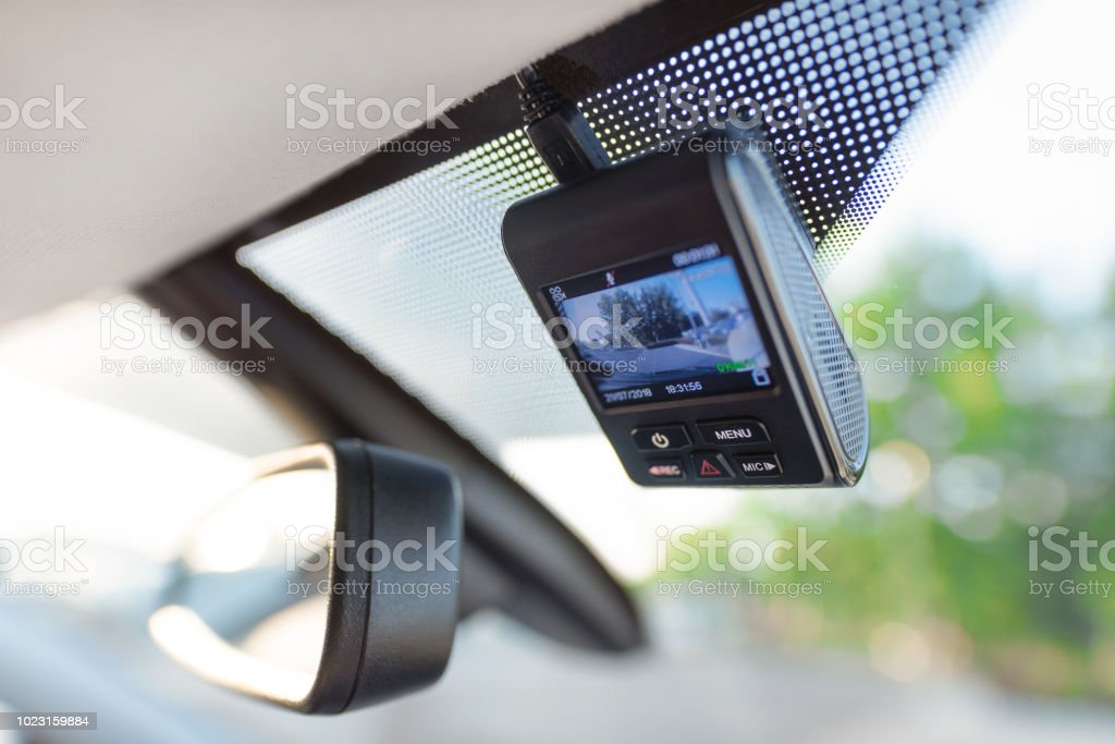 Video recorder next to a rear view mirror stock photo