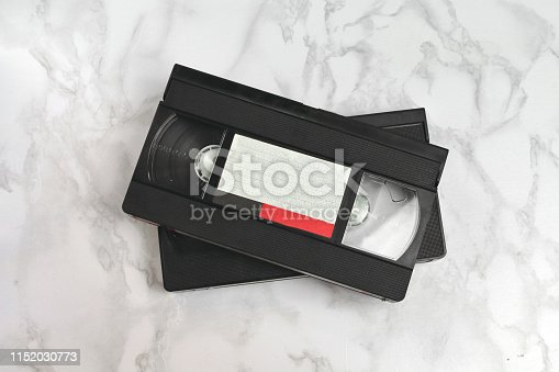 istock Video vhs retro vintage cassette tape 70s, 80s, 90s style on pink background 1152030773