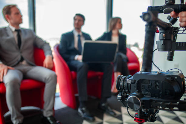 Videographer filming business meeting stock photo