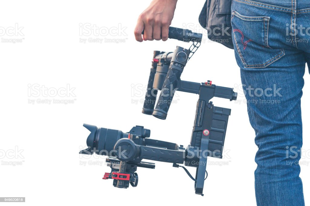 Videographer using camera gimbal stabiliser on white background, Professional equipment helps to make high quality video. stock photo