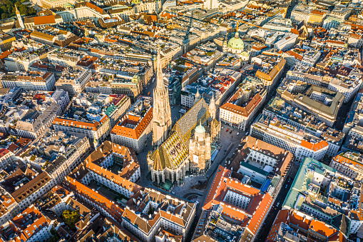 Vienna aerial view in Austria is one of the most famous capital cities of Europe. Flying by above Danube River, the historic city centre feat. old buildings around the downtown