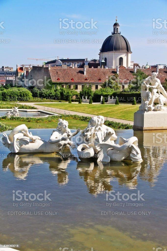 Vienna (Wien), Austria (Osterreich) - June 24, 2017 - Fountain sculptures in Belvedere Gardens with Salesianer church (Salesianerinnenkirche) stock photo