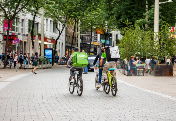 Vienna Austria May.25 2018, Uber Eats is an International food delivery company from U.S, Cyclist caring backpacks stock photo
