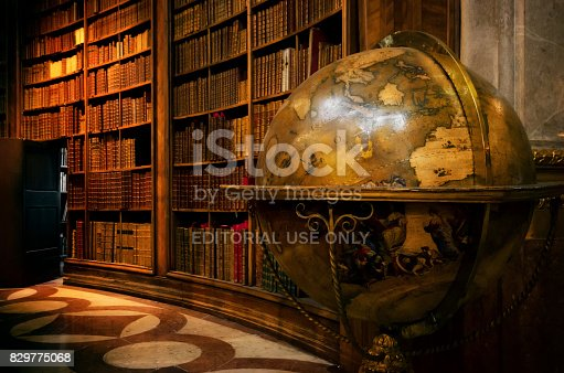 Vienna, Austria - May 20, 2017: Main hall of the historical Austrian National Library in Vienna (Austria) on may 20, 2017, with an ancient globe map