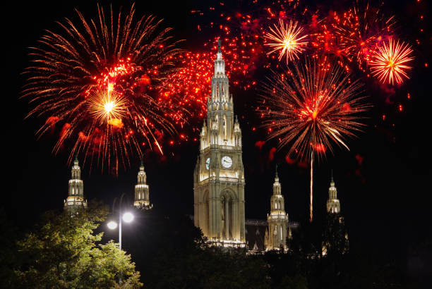 Vienna City Hall with fireworks in the background Vienna City Hall with fireworks in the background pyrotechnic effects stock pictures, royalty-free photos & images