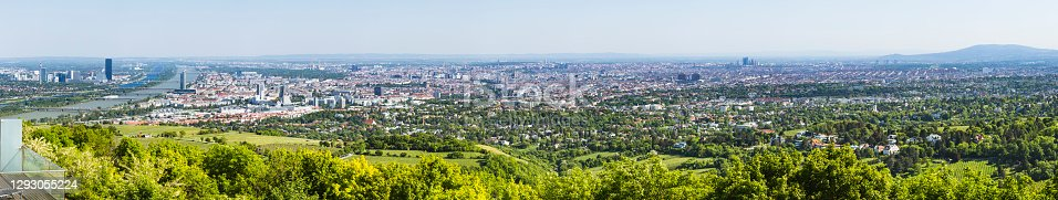 Panoramic view from a vineyard hill over the city center of Vienna, Austria including most churches and the Donau City.
