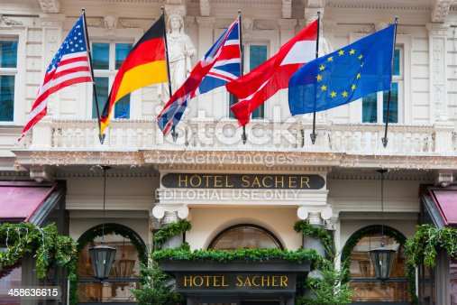Vienna, Austria - December 4, 2011: Famous Hotel Sacher Entrance in Downtown Vienna, Austria with several Flags, decorated during Christmas Time.