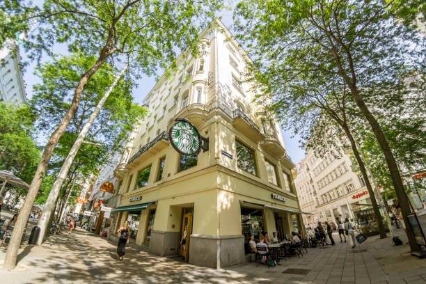 Vienna is the federal capital and largest city of Austria. Coffeehouse Starbucks in downtown, wide angle shot stock photo