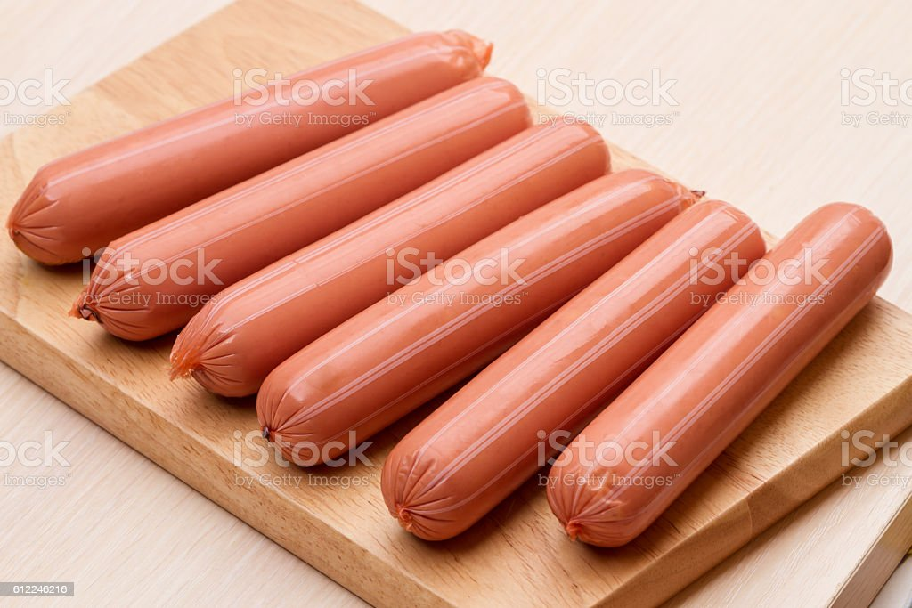 Vienna sausage on the kitchen board stock photo