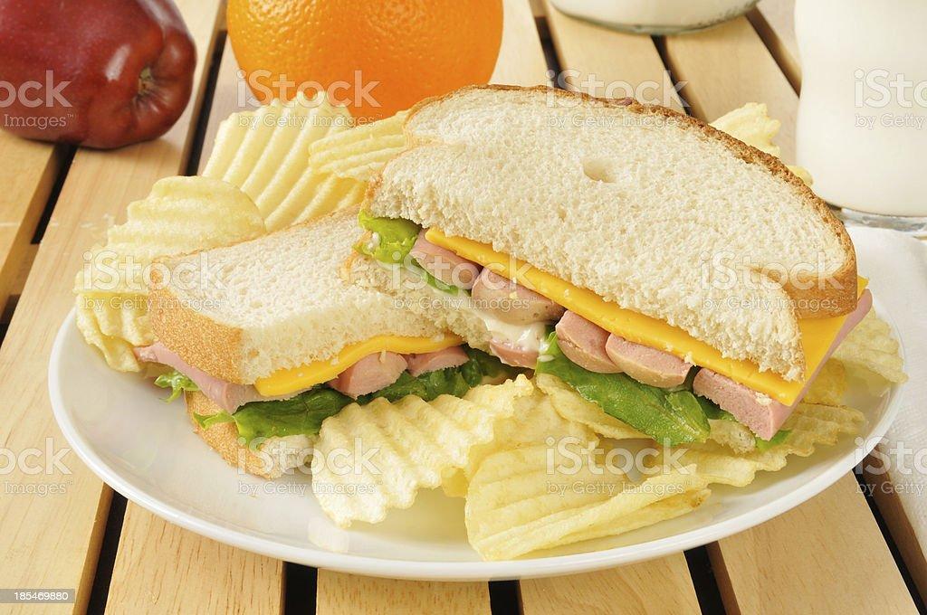 vienna sausage sandwich with potato chips stock photo