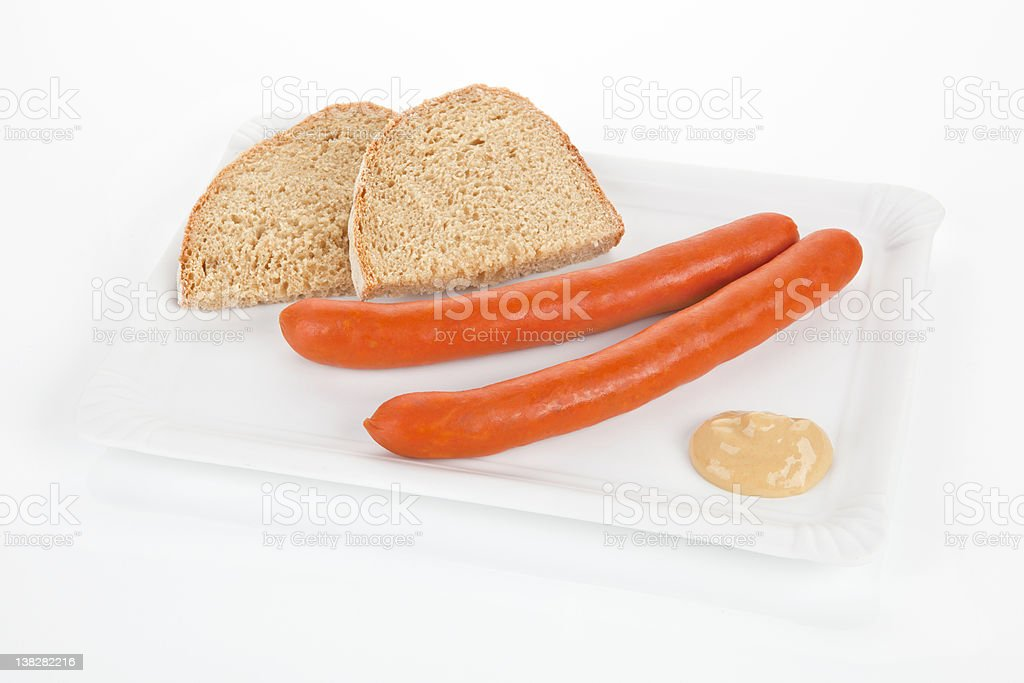 Vienna sausages, mustard and bread slices on white tray. stock photo