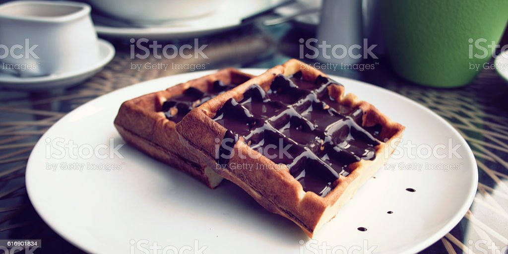Vienna Waffles with chocolate topping. Dessert. stock photo