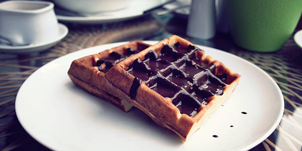Vienna Waffles with chocolate topping. Dessert. – Foto
