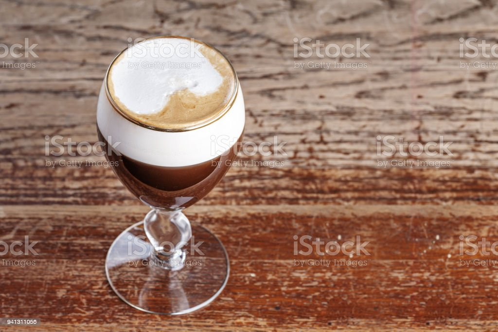 Viennese coffee with foam from cream - non-alcoholic drink on the bar in the cafe stock photo
