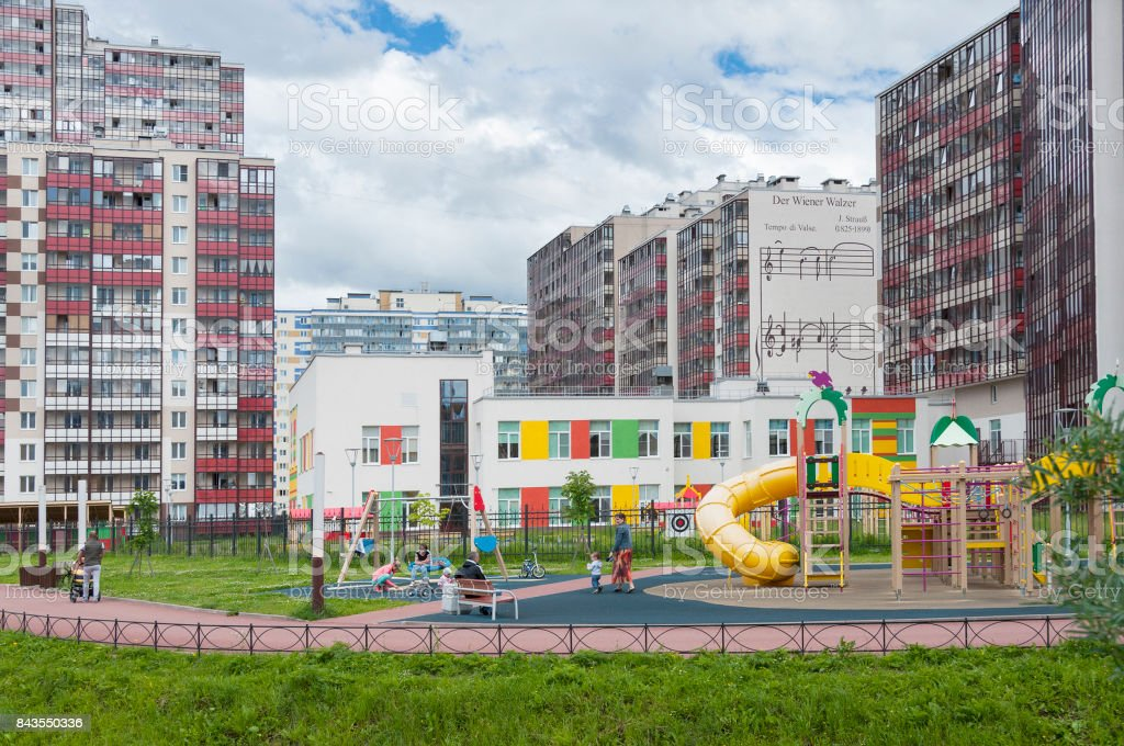 RUSSIA, SAINT-PETERSBURG, - JULY 02, 2017: Viennese waltz appartments and play ground in the village Kudrovo, Leningrad stock photo