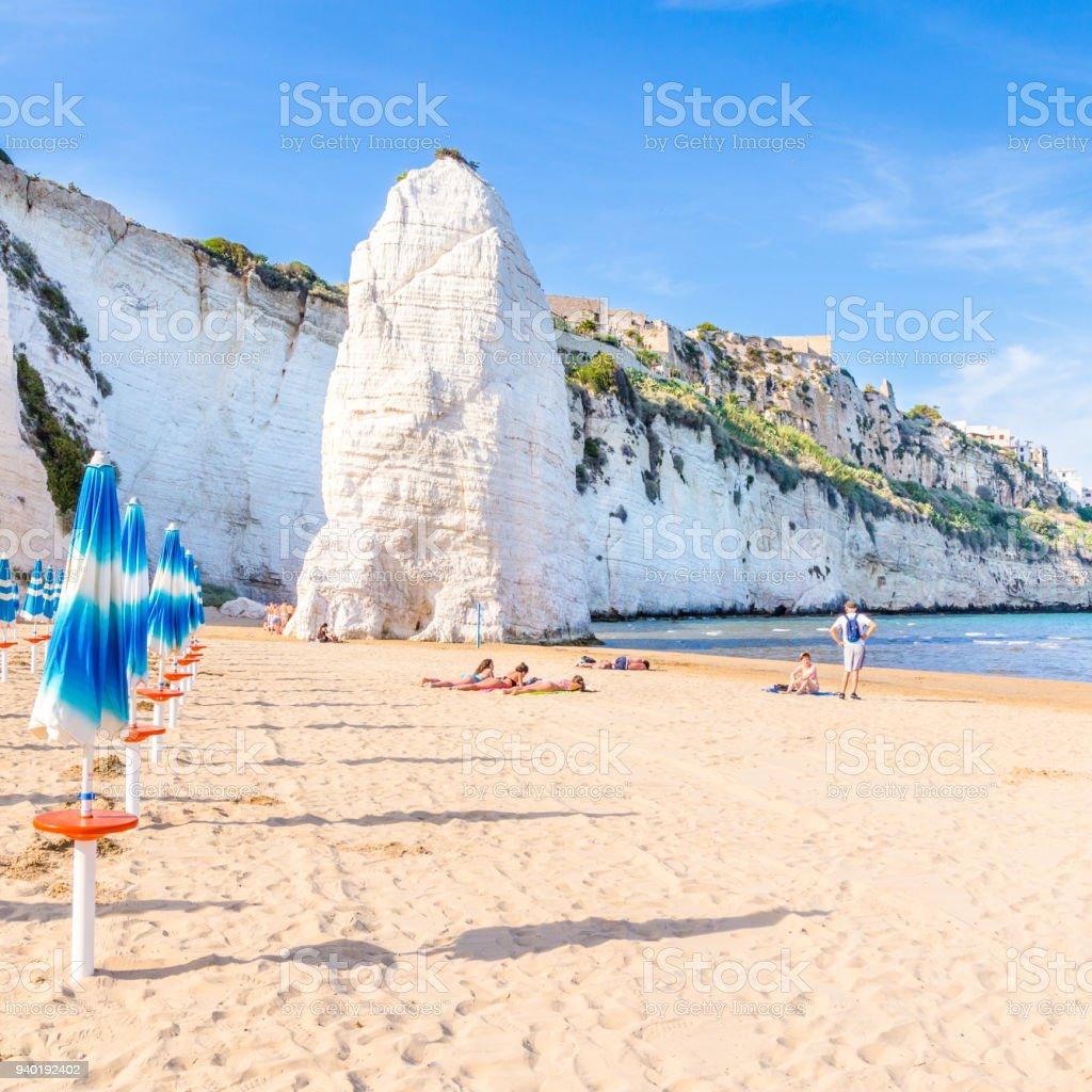 Vieste, Apulia, Italy, 30 May 2017. Beach of Pizzomunno rock, at Vieste, Apulia region , South  Italy stock photo