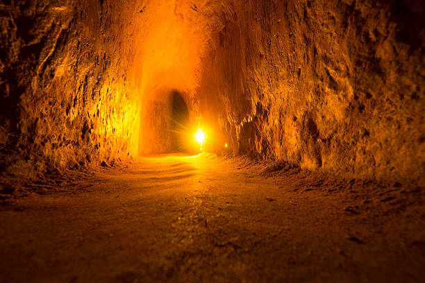 """Viet Cong guerrilla tunnel in Vietnam """"the tunnels were used by Viet Cong guerrillas as hiding spotsC!A>A Chi district of Ho Chi Minh City (Saigon), Vietnam"""" viet cong stock pictures, royalty-free photos & images"""