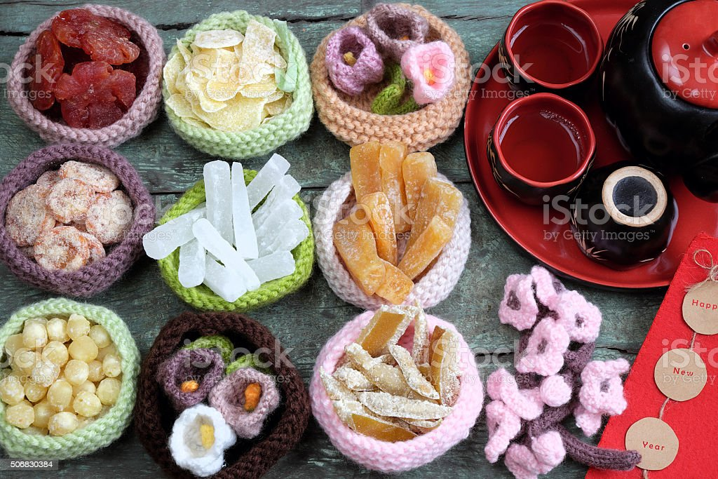 Vietnam culture, Vietnamese food, Tet, lunar new year Amazing of Vietnamese food for Tet holiday in spring, jam is traditional food on lunar new year, make from sweet potato, lotus seed, ginger, mango with sugar, colorful background for Vietnam culture Asia Stock Photo