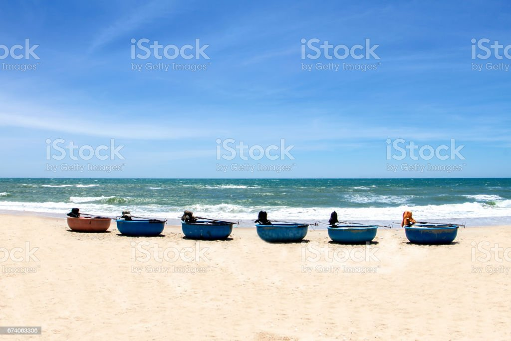 Vietnam fishing tools and beautiful white beach with blue sky in Vietnam royalty-free stock photo