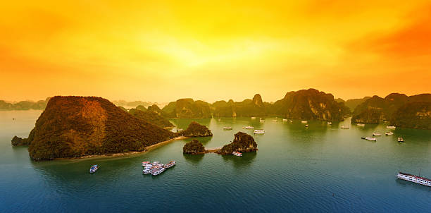 Vietnam Halong Bay beautiful sunset landscape Vietnam Halong Bay beautiful sunset landscape background hanoi stock pictures, royalty-free photos & images
