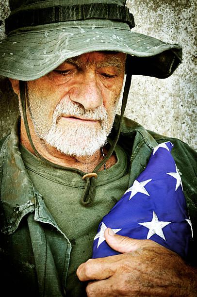 Vietnam Vet with Folded Flag Recalls the War (Xpro) stock photo