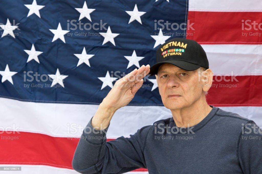 Vietnam Veteran Saluting Looking Angry Wearing Veterans Cap With ... cfbc1398909