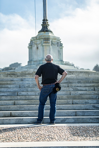 USA Vietnam Veteran Standing Near Military Cemetery Monument