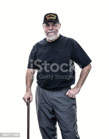 Vietnam Veteran Standing With Walking Cane