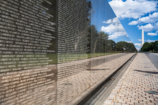 Washington D.C., USA - September 23, 2012: Vietnam Veterans War Memorial with the Washington Monument on the National Mall.