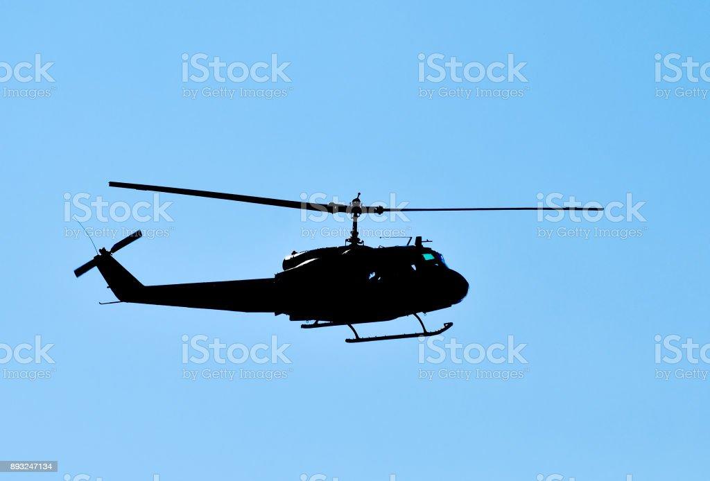 Vietnam War Era Helicopter In Flight Stock Photo - Download