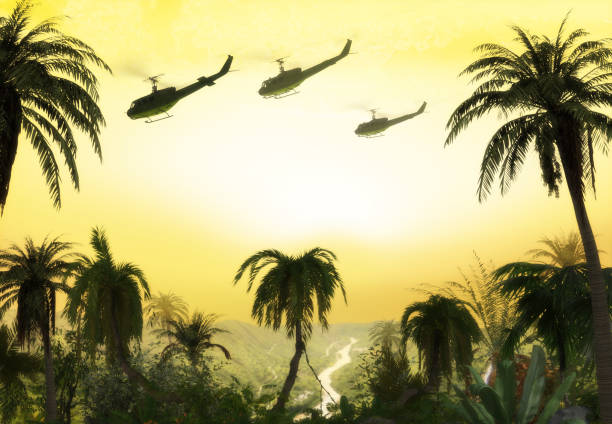 Vietnam War - Helicopter Formation over Jungle American Huey military helicopter formation flying over the jungle at sunset during the Vietnam War. 3d render. viet cong stock pictures, royalty-free photos & images