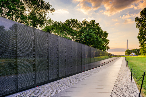 Washington DC, USA - June 18, 2016: The Memorial Wall of the Vietnam Veterans Memorial in Washington DC at dawn.