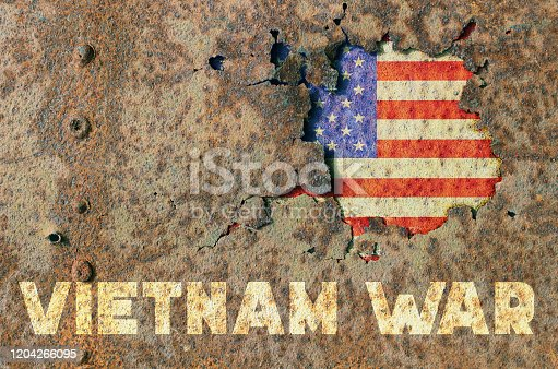 American flag and inscription Vietnam war on rusty armor of a military vehicle
