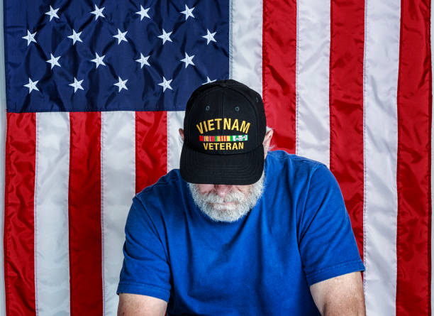 usa vietnam war us navy military veteran looking down - man face down stock pictures, royalty-free photos & images